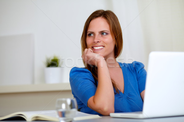 Reflective beautiful student woman smiling Stock photo © pablocalvog