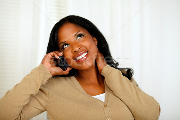 Charming young woman conversing on mobile phone Stock photo © pablocalvog