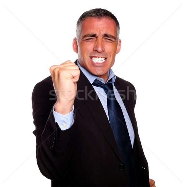 Positif homme d'affaires excité portrait costume noir isolé Photo stock © pablocalvog
