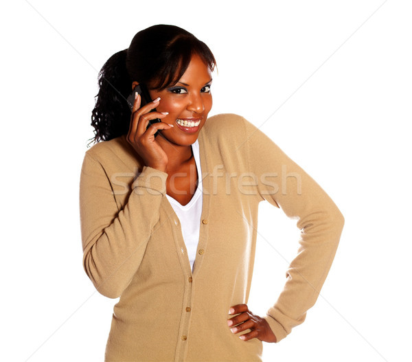 Happy young woman looking at you with cellphone Stock photo © pablocalvog