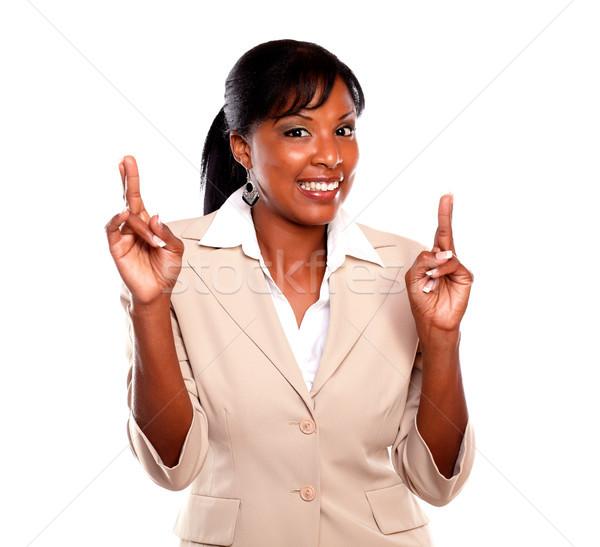 довольно деловая женщина улыбаясь пальцы белый бизнеса Сток-фото © pablocalvog