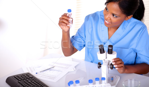 Beautiful scientific woman looking to test tube Stock photo © pablocalvog