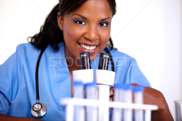 Medical doctor woman looking at you Stock photo © pablocalvog