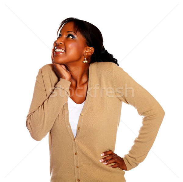 Happy young woman looking up Stock photo © pablocalvog