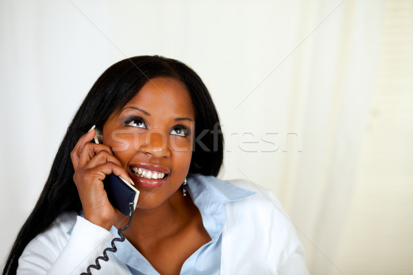 Pretty woman smiling and conversing on phone Stock photo © pablocalvog