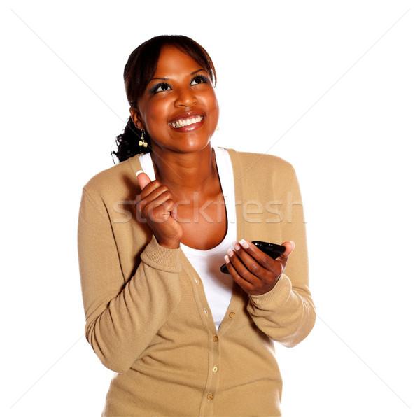 Heureux jeune femme isolé mobiles Photo stock © pablocalvog