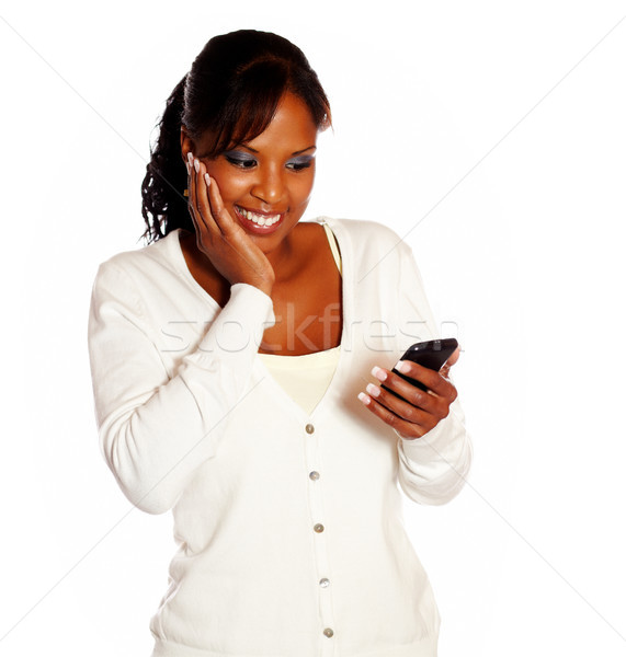 Adult woman reading message on mobile phone Stock photo © pablocalvog