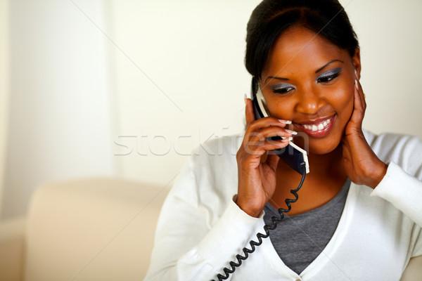 Kadın telefon portre oturma kanepe ev Stok fotoğraf © pablocalvog