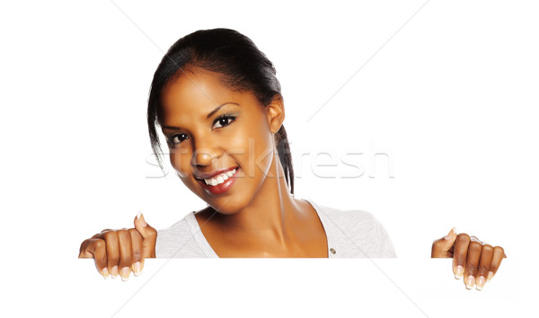Woman holding a signboard Stock photo © pablocalvog