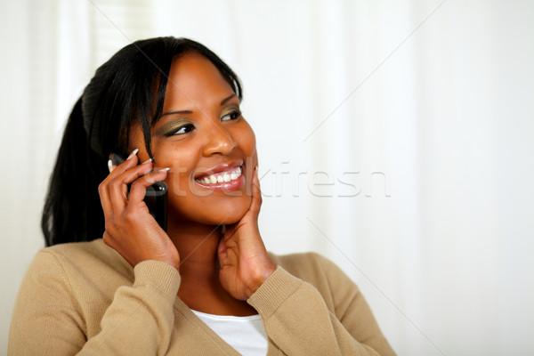 Fresh woman smiling and conversing on mobile Stock photo © pablocalvog