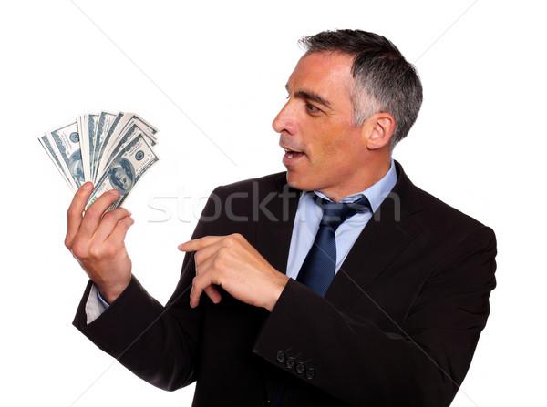 Ambicioso executivo olhando dólares retrato isolado Foto stock © pablocalvog