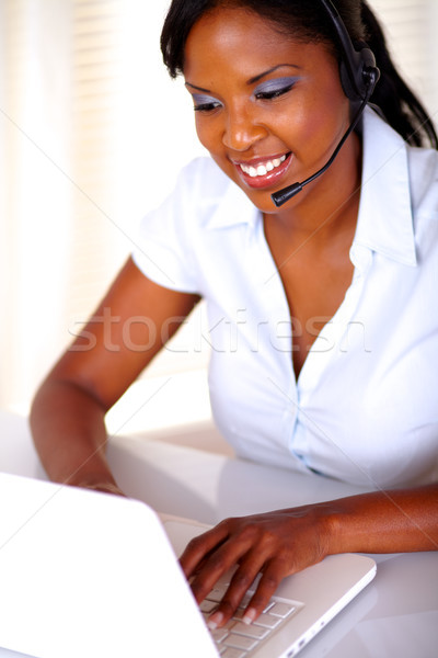 Smiling operator conversing on microphone Stock photo © pablocalvog