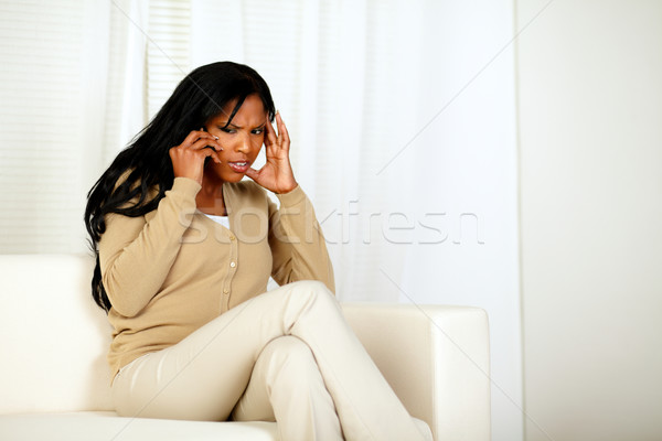 Stock photo: Attractive woman conversing on cellphone