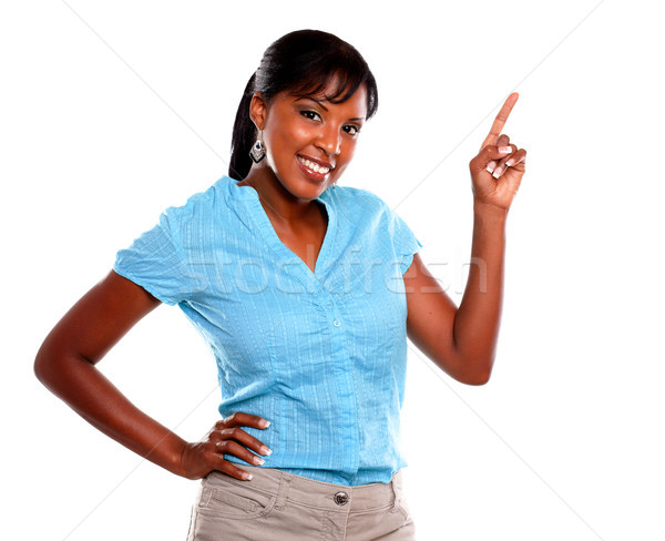 Adult woman looking at you and pointing up Stock photo © pablocalvog