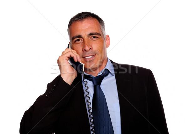 Charyzmatyczny biznesmen uśmiechnięty telefonu portret czarny garnitur Zdjęcia stock © pablocalvog