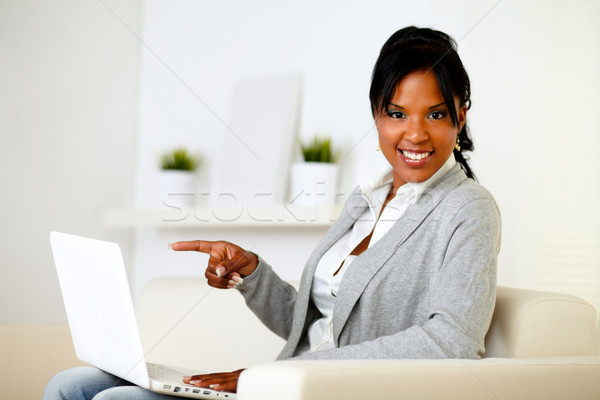 Stock photo: Afro-american woman pointing to laptop screen