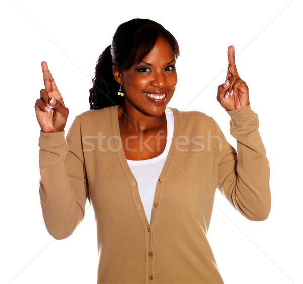 Female with winning attitude crossing fingers Stock photo © pablocalvog