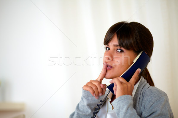Young woman requesting silence speaking on phone Stock photo © pablocalvog