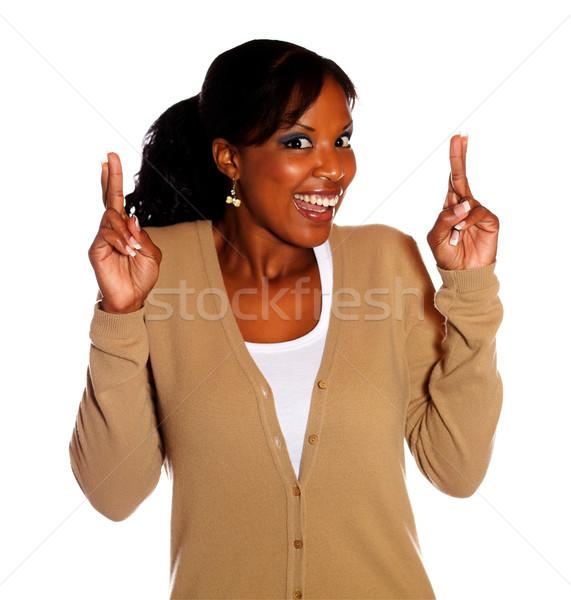 Nő nyerő hozzáállás ujjak boldog fiatal nő Stock fotó © pablocalvog