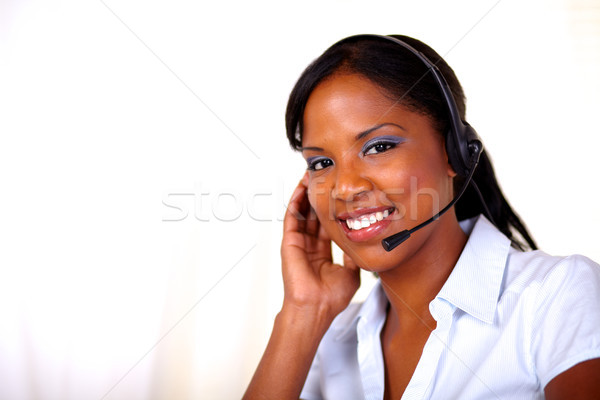 Attractive receptionist smiling and looking at you Stock photo © pablocalvog