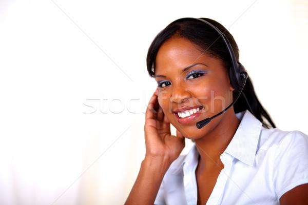 Atrakcyjny recepcjonista uśmiechnięty patrząc mikrofon Zdjęcia stock © pablocalvog
