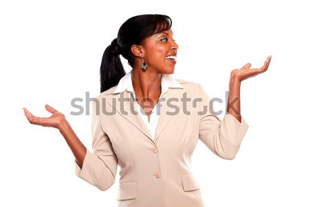Stylish executive woman looking left and arms up Stock photo © pablocalvog