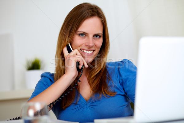 Joli jeune femme souriant téléphone portrait maison Photo stock © pablocalvog