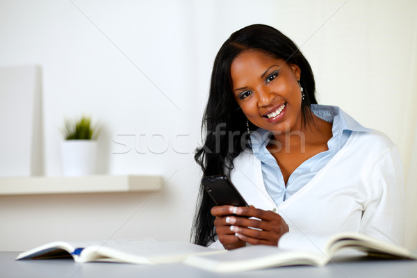 Afro-american young woman looking to you Stock photo © pablocalvog