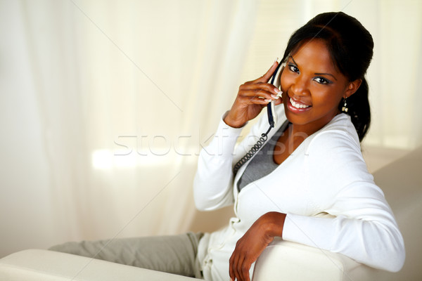 Beautiful young woman looking at you with phone Stock photo © pablocalvog