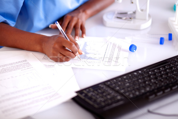 Scientific woman studying documents Stock photo © pablocalvog