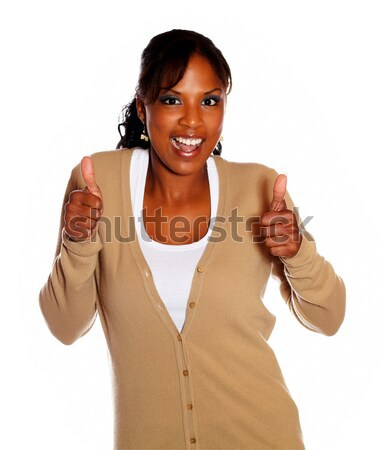 Positive young woman lifting the fingers up Stock photo © pablocalvog