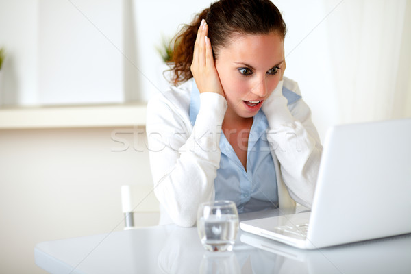 Surprised and stressed young woman reading Stock photo © pablocalvog