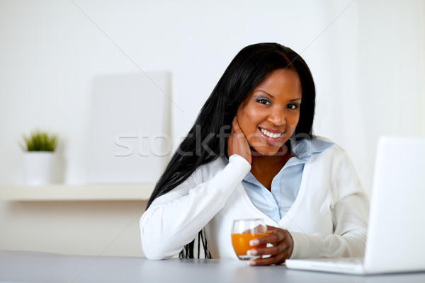 Afro-american woman with an orange juice Stock photo © pablocalvog