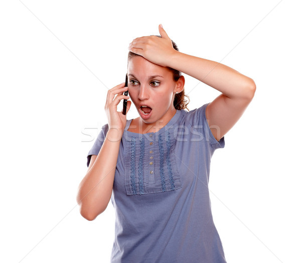 Surprised young female speaking on mobile phone Stock photo © pablocalvog