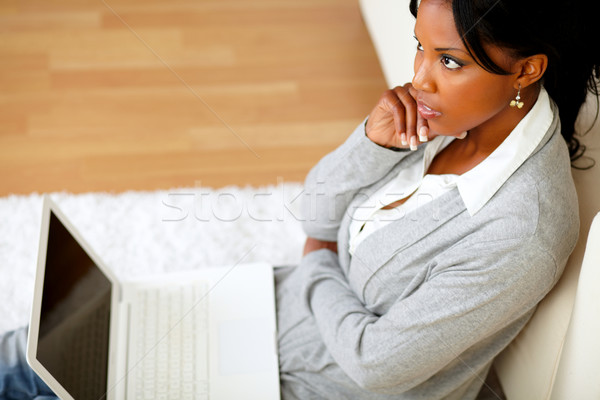 Pensive young woman is sitting on the floor Stock photo © pablocalvog