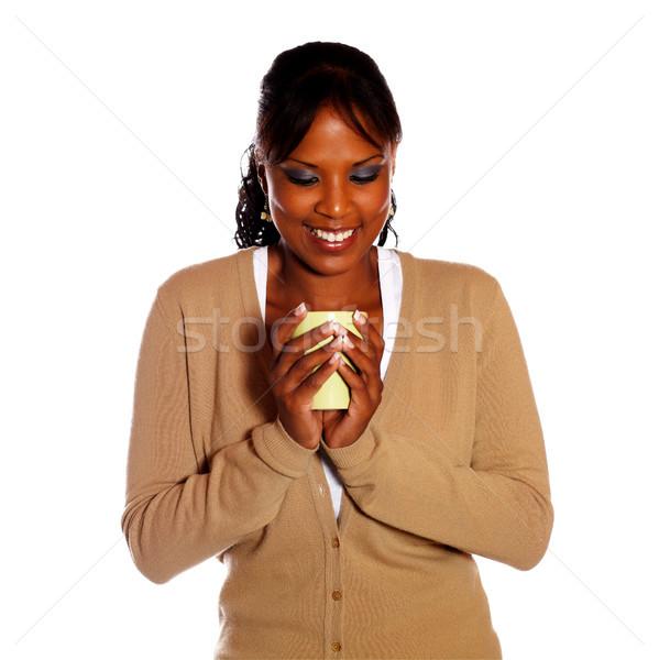 Beautiful young woman contemplating coffee mug Stock photo © pablocalvog