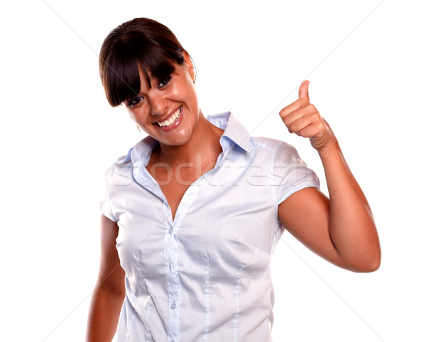 Friendly young woman with a winning attitude Stock photo © pablocalvog