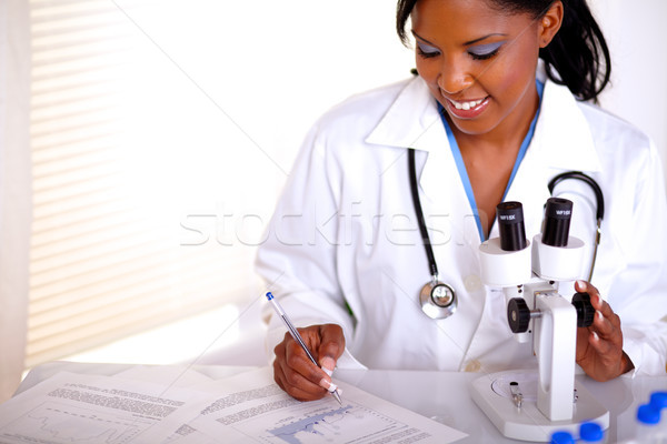 Medical doctor young woman working at laboratory Stock photo © pablocalvog