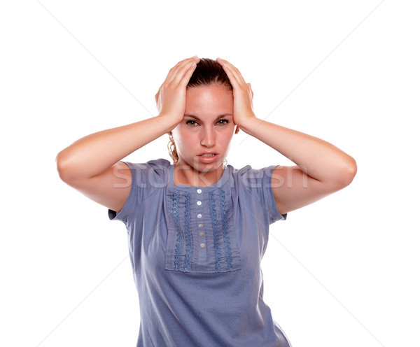 Infeliz mulher jovem terrível dor de cabeça em pé branco Foto stock © pablocalvog