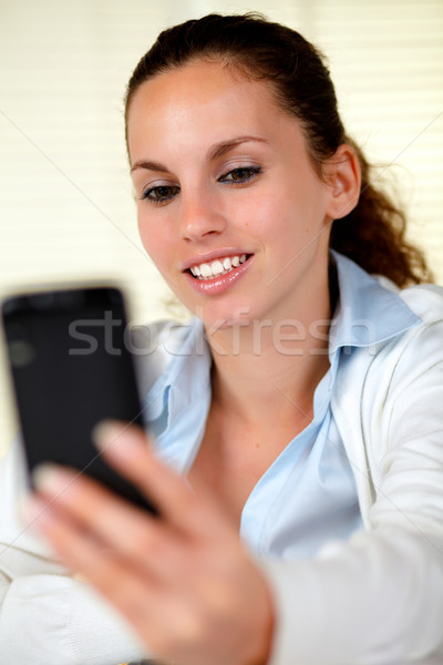 Caucasian woman browsing the internet on cellphone Stock photo © pablocalvog