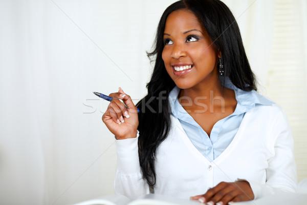 Réfléchissant jeune femme souriant étudier portrait soft Photo stock © pablocalvog