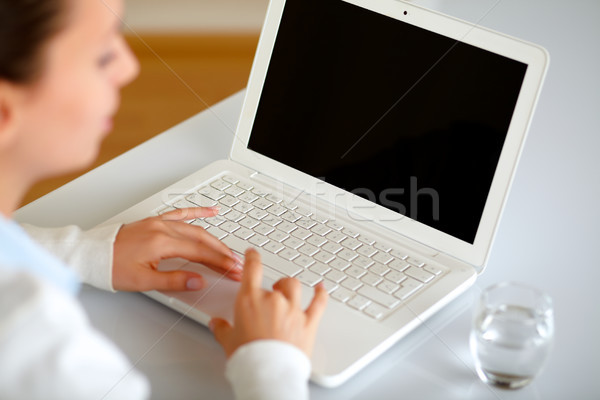 Pretty young woman browsing the internet Stock photo © pablocalvog