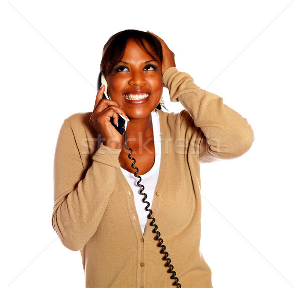 Happy and excited female conversing on phone Stock photo © pablocalvog