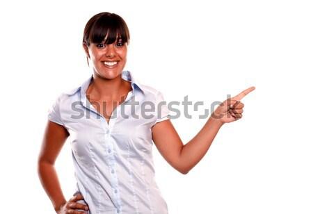 Stok fotoğraf: Genç · kadın · gülen · işaret · yukarı · yalıtılmış