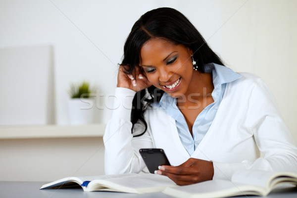 Prettty lovely woman smiling with cellphone Stock photo © pablocalvog
