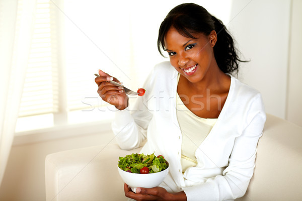 Pretty and smiling girl eating a salad Stock photo © pablocalvog