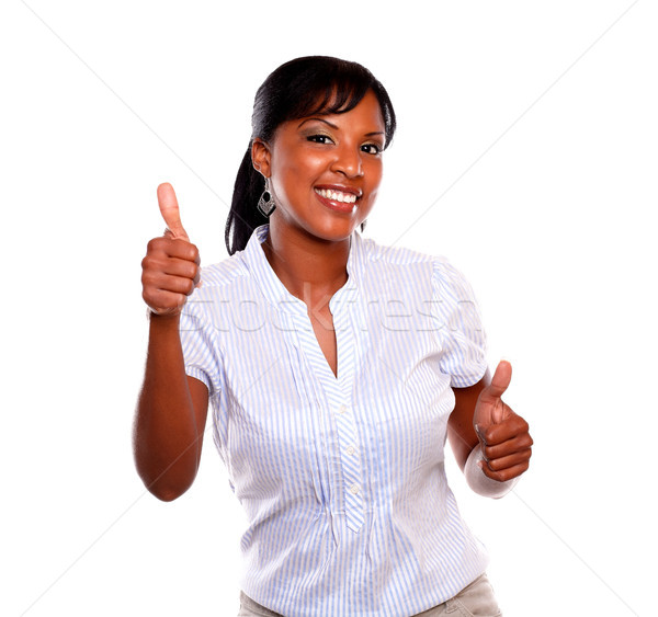 Smiling young female with a winning attitude Stock photo © pablocalvog