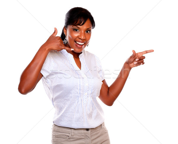 Gülümseyen kadın işaret bakıyor yalıtılmış Stok fotoğraf © pablocalvog