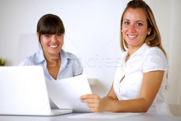 улыбаясь предпринимателей чтение документы ноутбука Сток-фото © pablocalvog