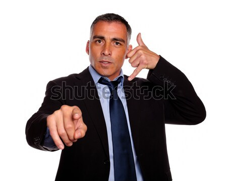 Hispanic senior broker pointing Stock photo © pablocalvog